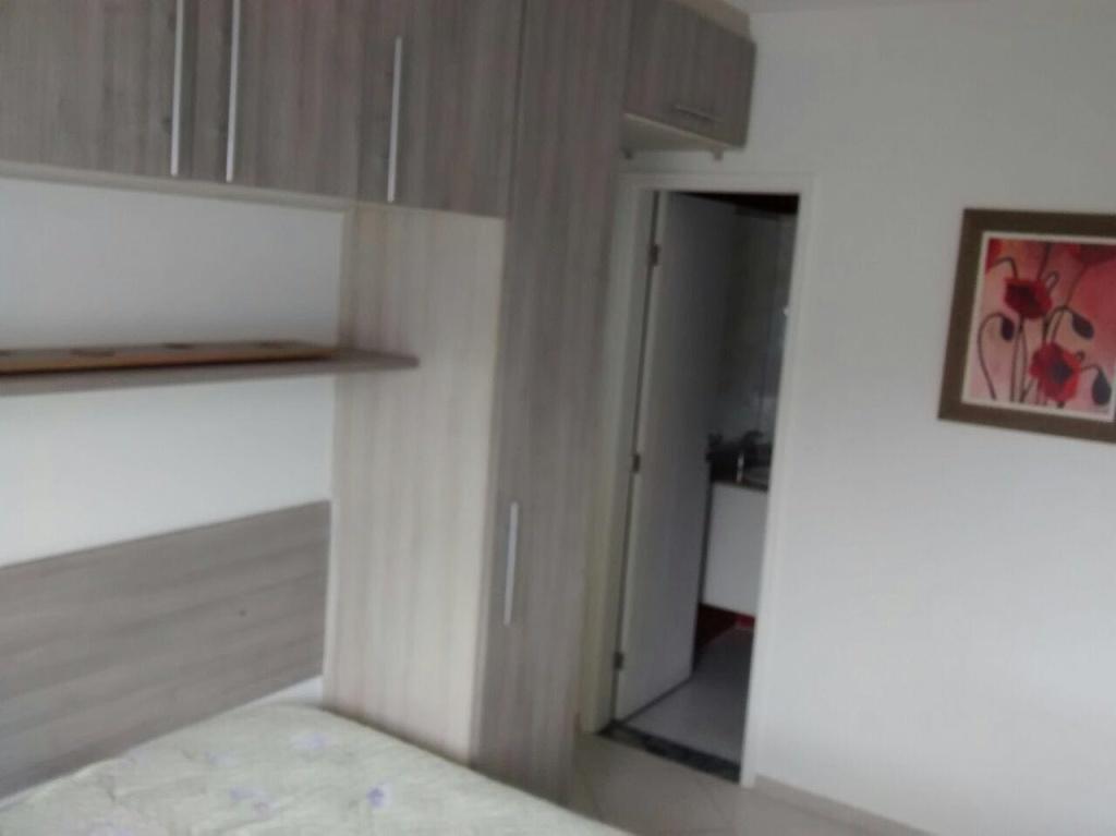 Dormitório Suíte do apartamento com 2 dormitórios em CANTO DO FORTE - PRAIA GRANDE