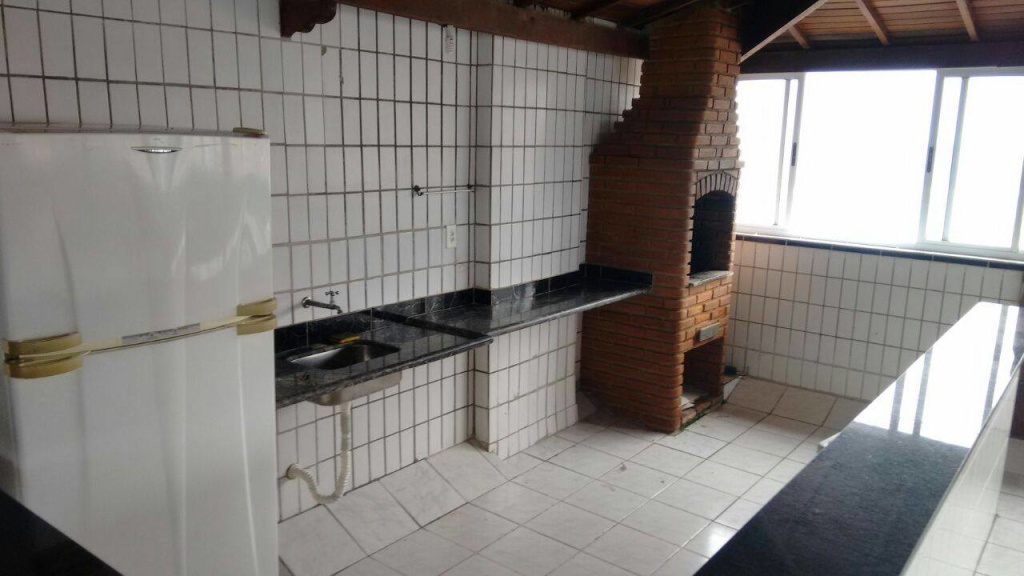 Cozinha do salão ang 02 do apartamento com 2 dormitórios em OCIAN - PRAIA GRANDE