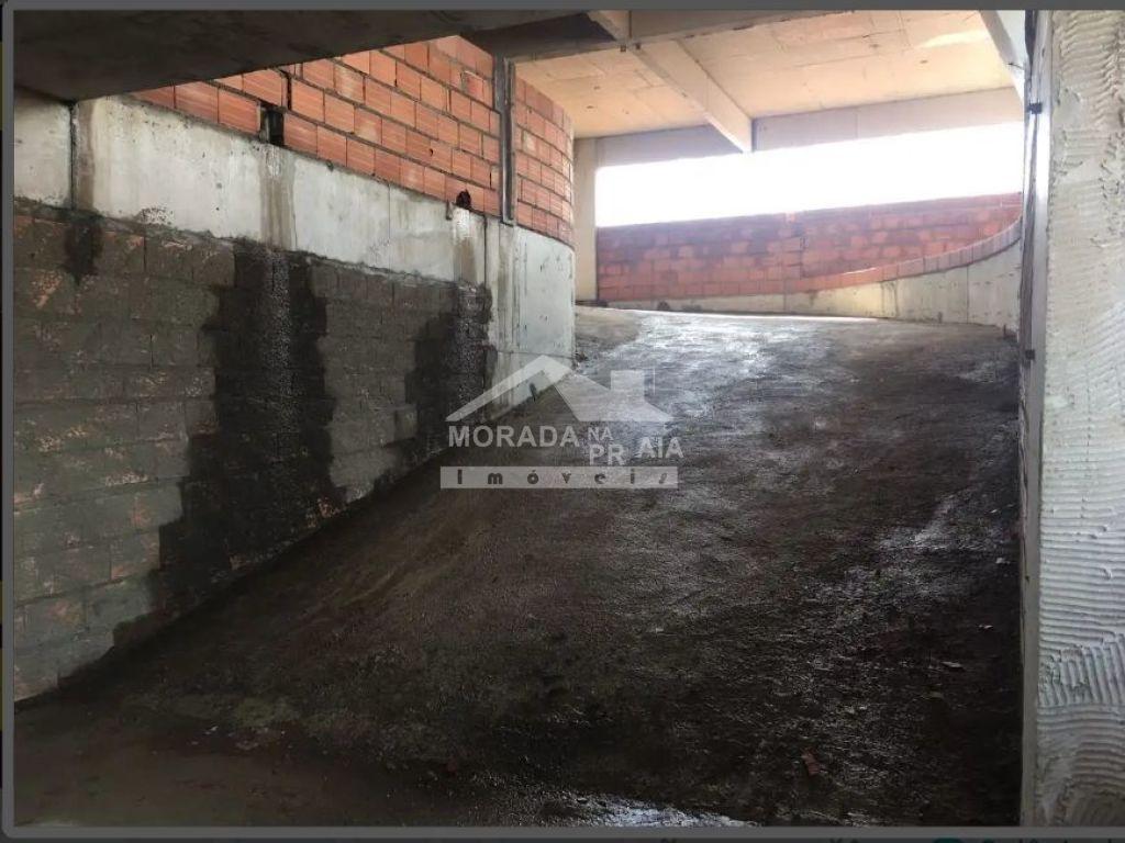Rampa de acesso garagem do apartamento com 2 dormitórios em MIRIM - PRAIA GRANDE