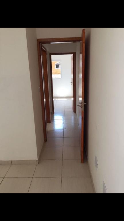 Dormitório 1 do condomínio fechado com 2 dormitórios em TUPI - PRAIA GRANDE