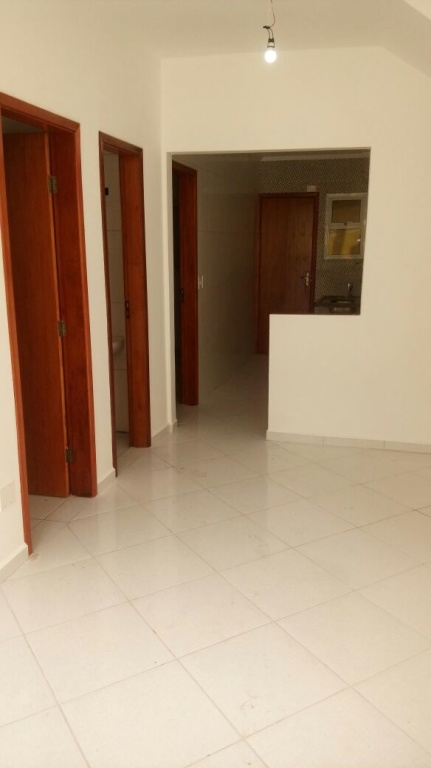 Sala do condomínio fechado com 2 dormitórios em MELVI - PRAIA GRANDE