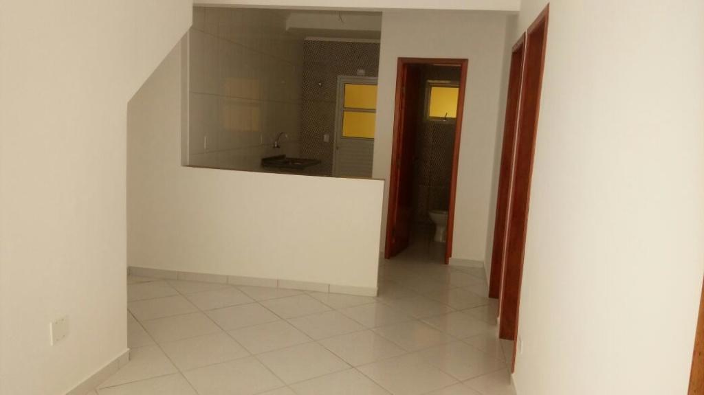 Sala do condomínio fechado com 2 dormitórios em Jardim Melvi - Praia Grande