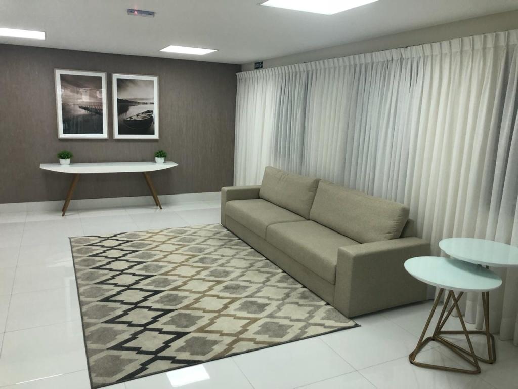 Sala de entrada do prédio do apartamento com 3 dormitórios em Vila Guilhermina - Praia Grande