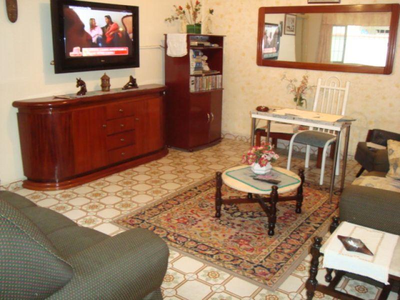 Sala do casa geminada com 3 dormitórios em GUILHERMINA - PRAIA GRANDE