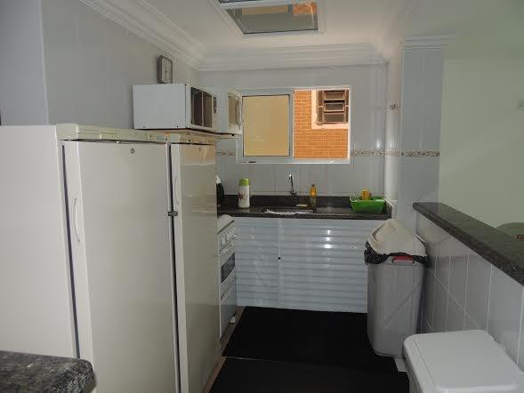 Cozinha do salão ang 02 do apartamento com 2 dormitórios em CANTO DO FORTE - PRAIA GRANDE