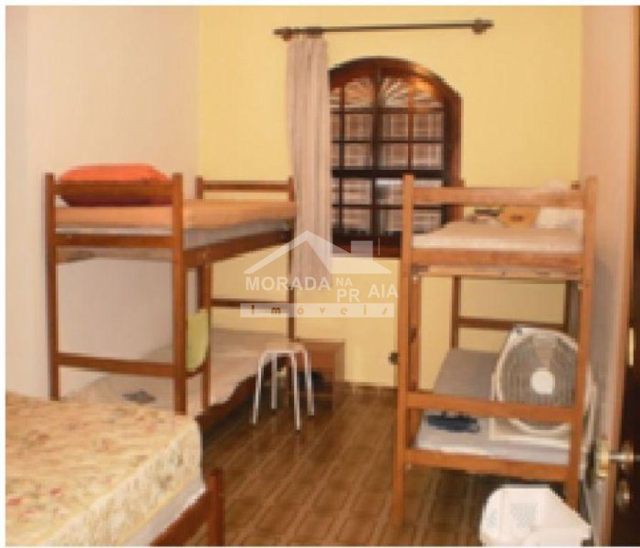 Suíte do casa geminada com 3 dormitórios em MIRIM - PRAIA GRANDE