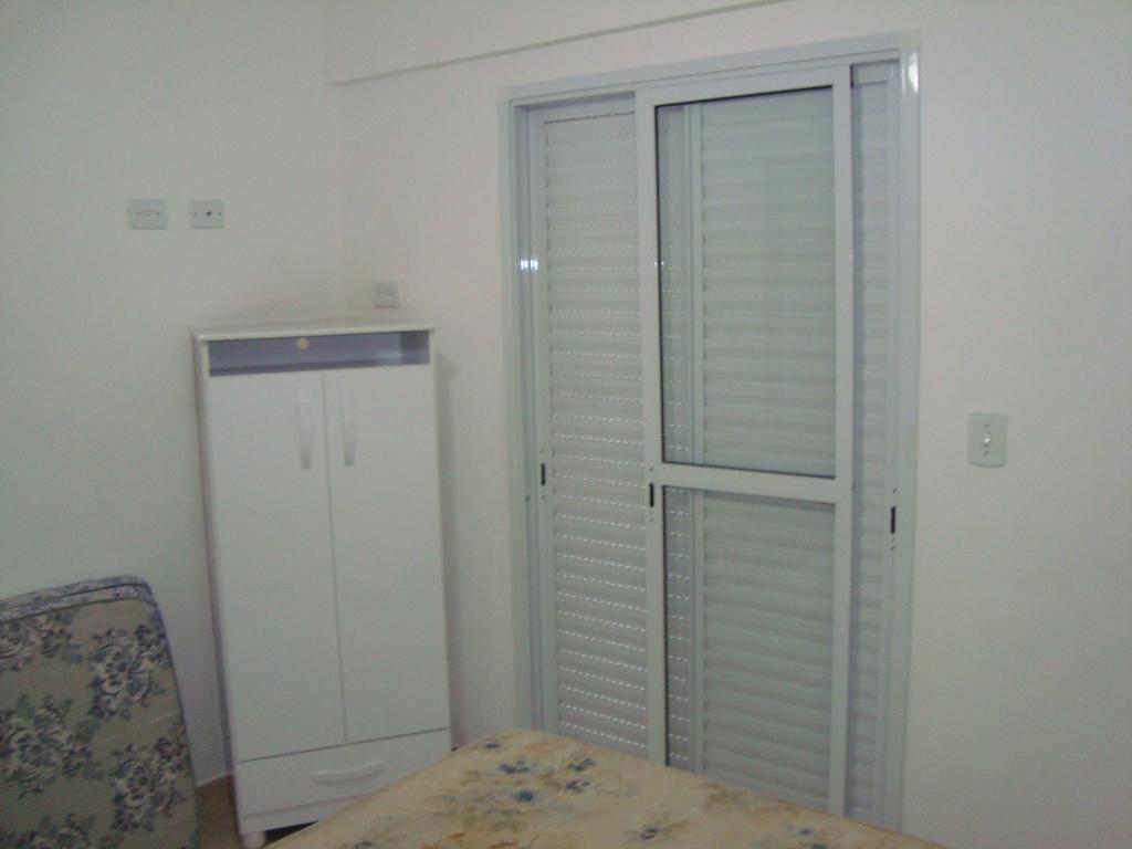 Suíte do apartamento com 2 dormitórios em AVIAÇÃO - PRAIA GRANDE