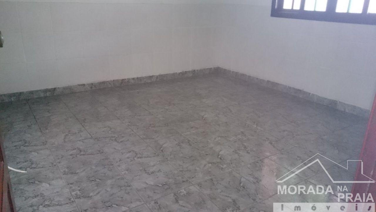 Sala do casa geminada com 2 dormitórios em Vila Tupi - Praia Grande