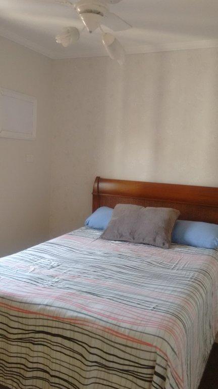 Suíte ang 1 do apartamento com 2 dormitórios em TUPI - PRAIA GRANDE