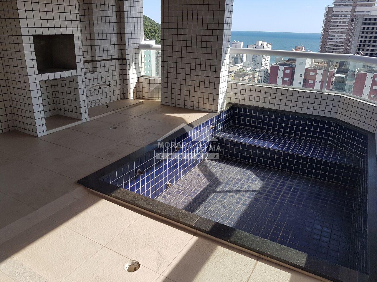 Churrasqueira e pia do apartamento com 3 dormitórios em CANTO DO FORTE - PRAIA GRANDE